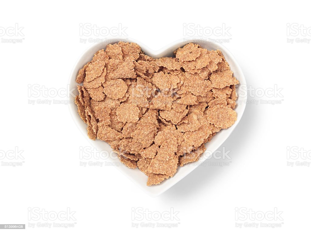 heart shaped bowl bran cereal - Stock Image stock photo