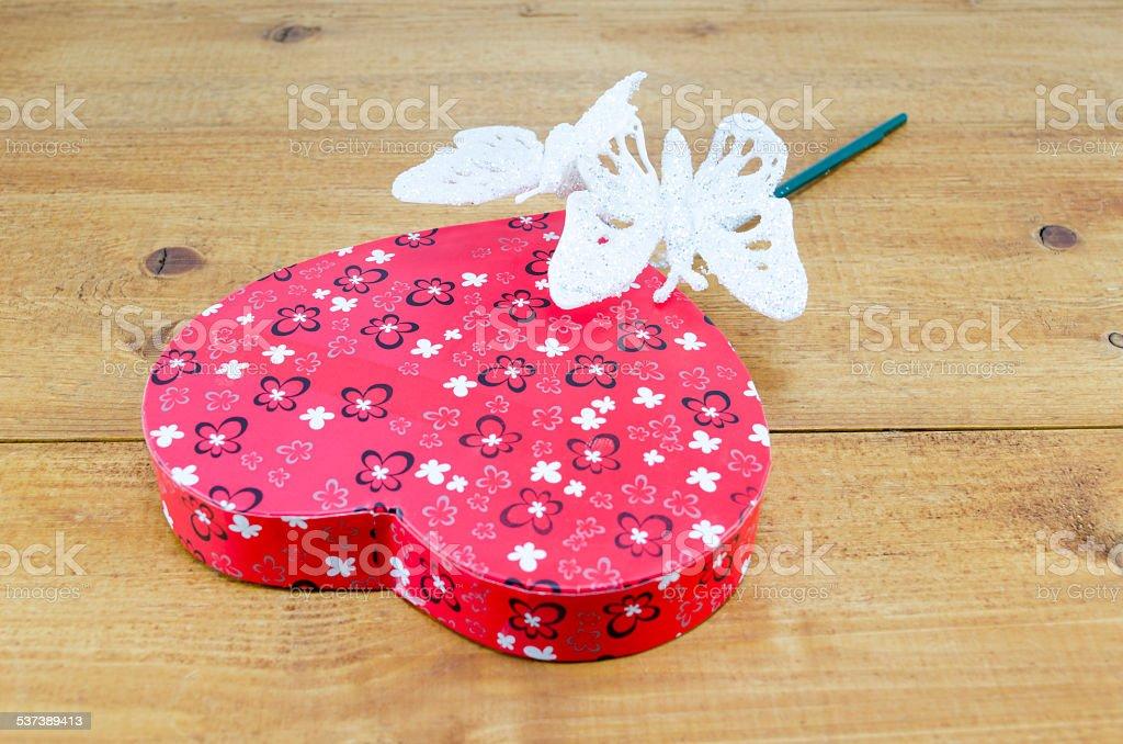 Heart shaped box and a magic wand royalty-free stock photo
