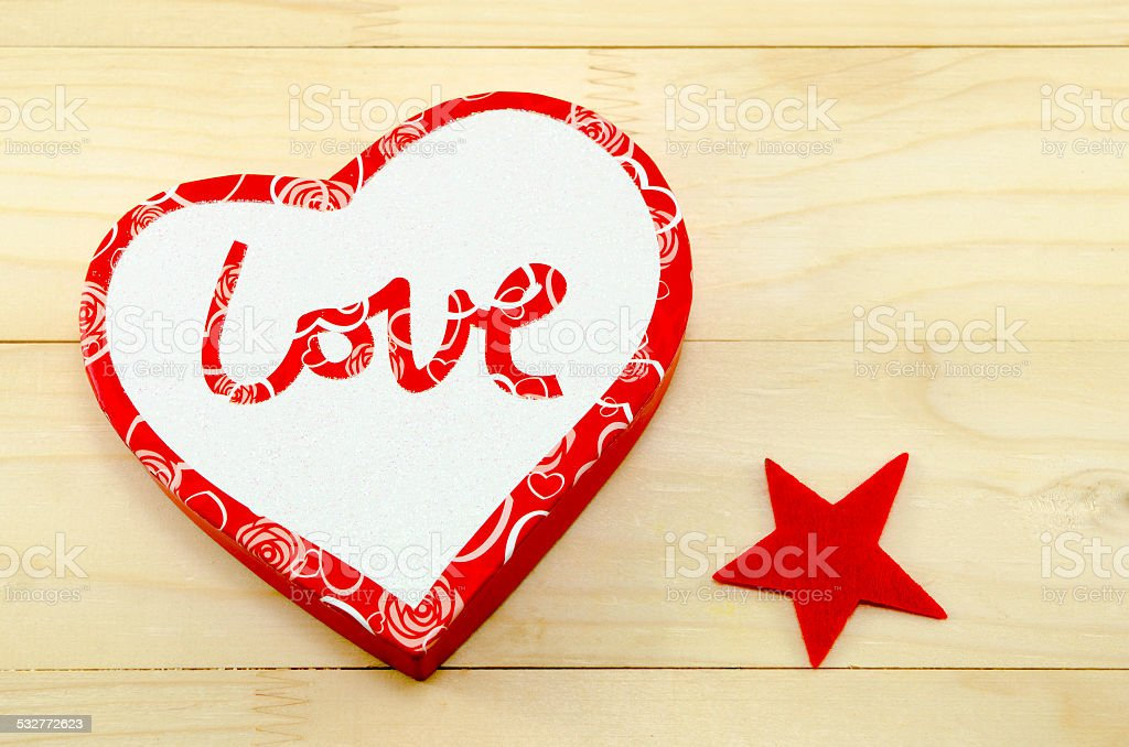 Heart shaped box and a red star royalty-free stock vector art