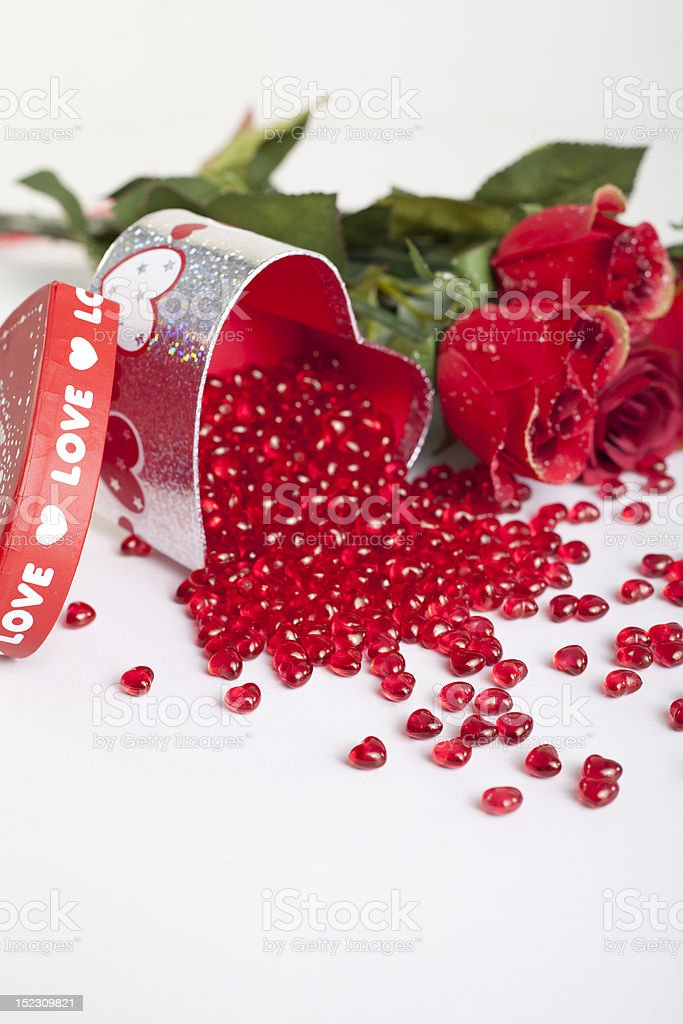 Heart shaped box filled with little red gems royalty-free stock photo