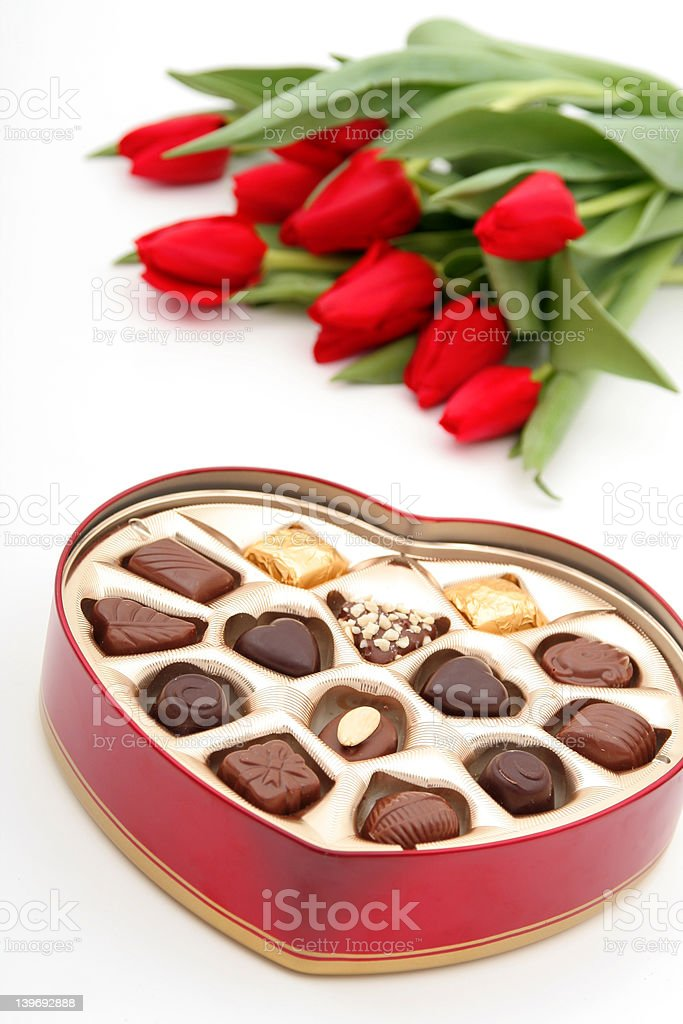 Heart Shaped Box of Candy and Tulips royalty-free stock photo