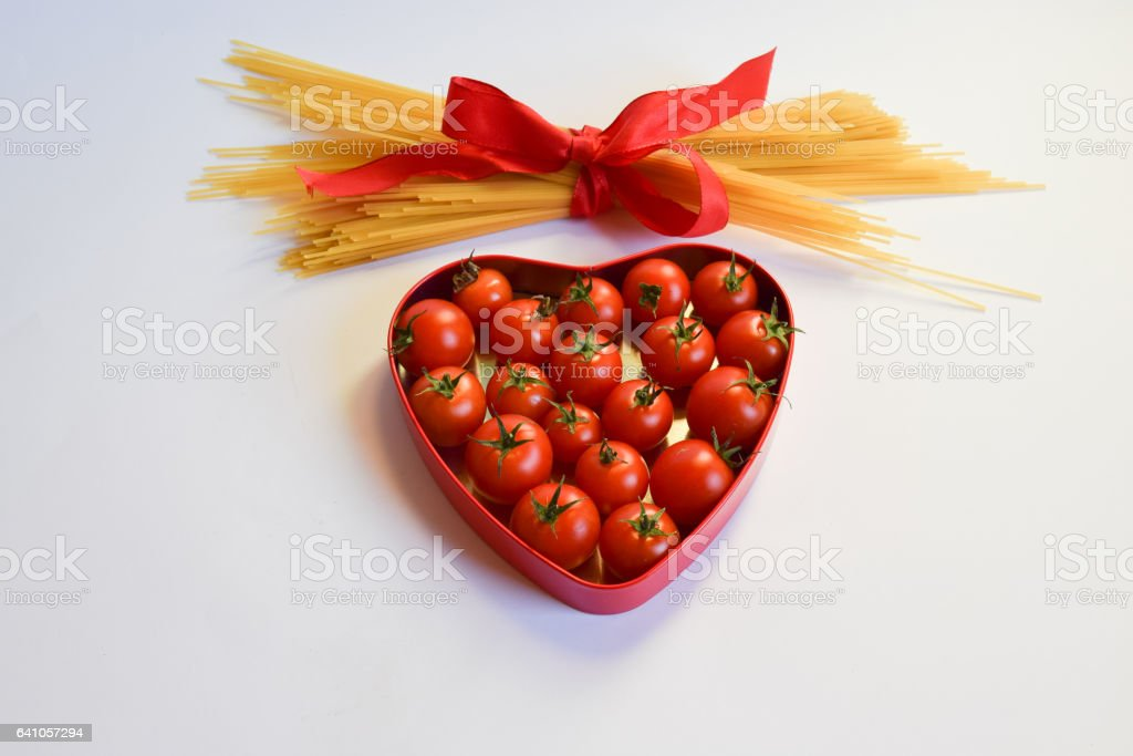 heart shaped box of red tomatoes stock photo