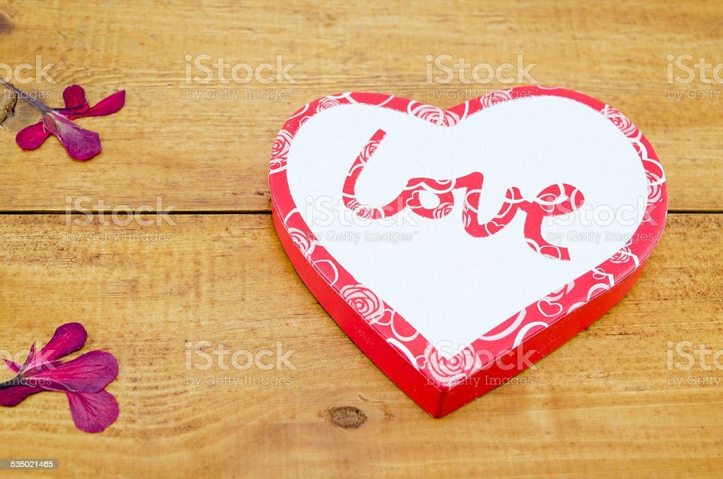 Heart shaped box on a wooden table royalty-free stock photo