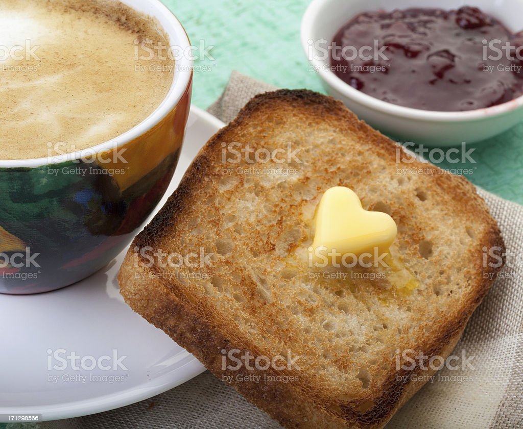 Heart shaped butter on toast with coffee royalty-free stock photo