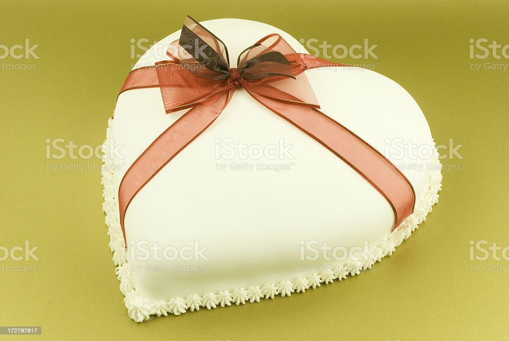 Heart Shaped Cake with red ribbon royalty-free stock photo