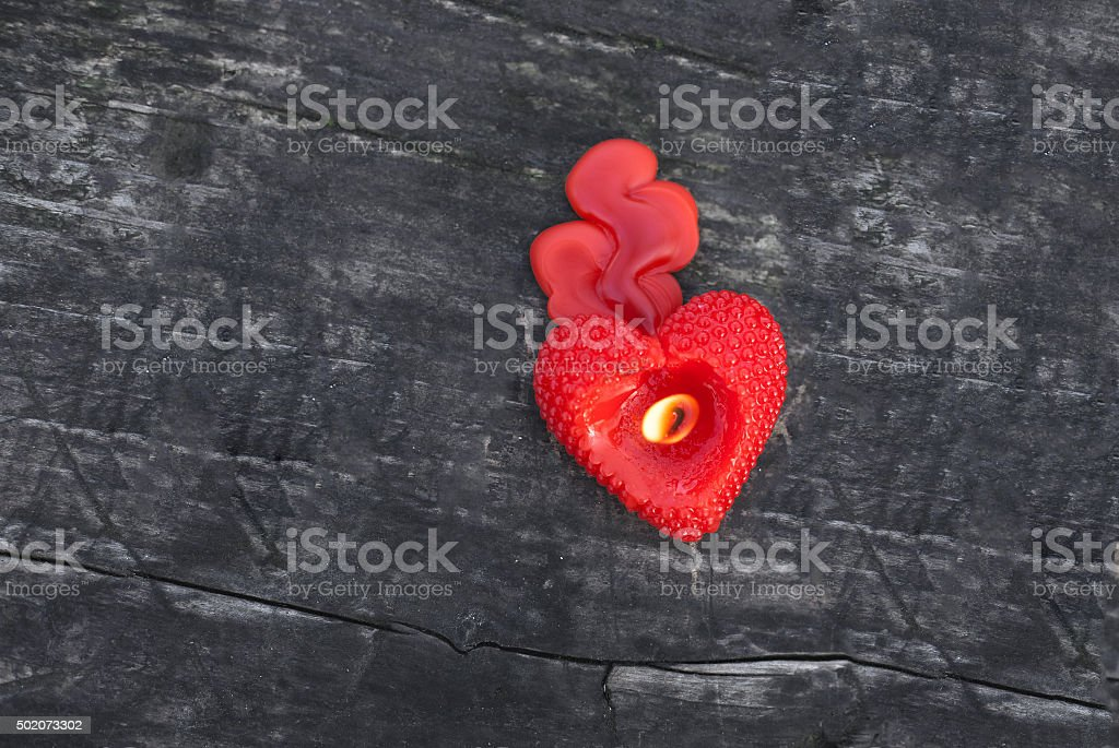Heart shaped candle on the wooden table royalty-free stock photo