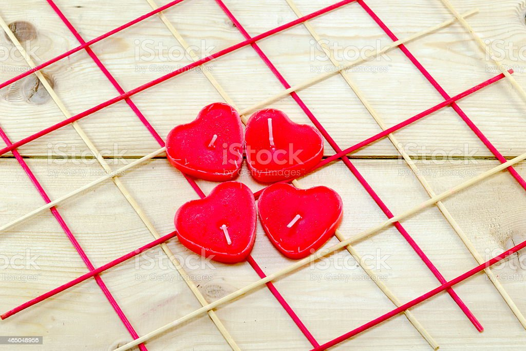 Heart shaped candles on a wooden table royalty-free stock photo