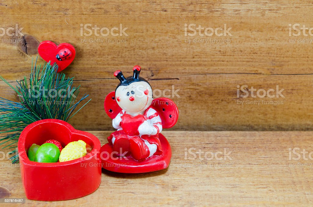 Heart shaped ceramic box and a ladybug ornament royalty-free stock photo