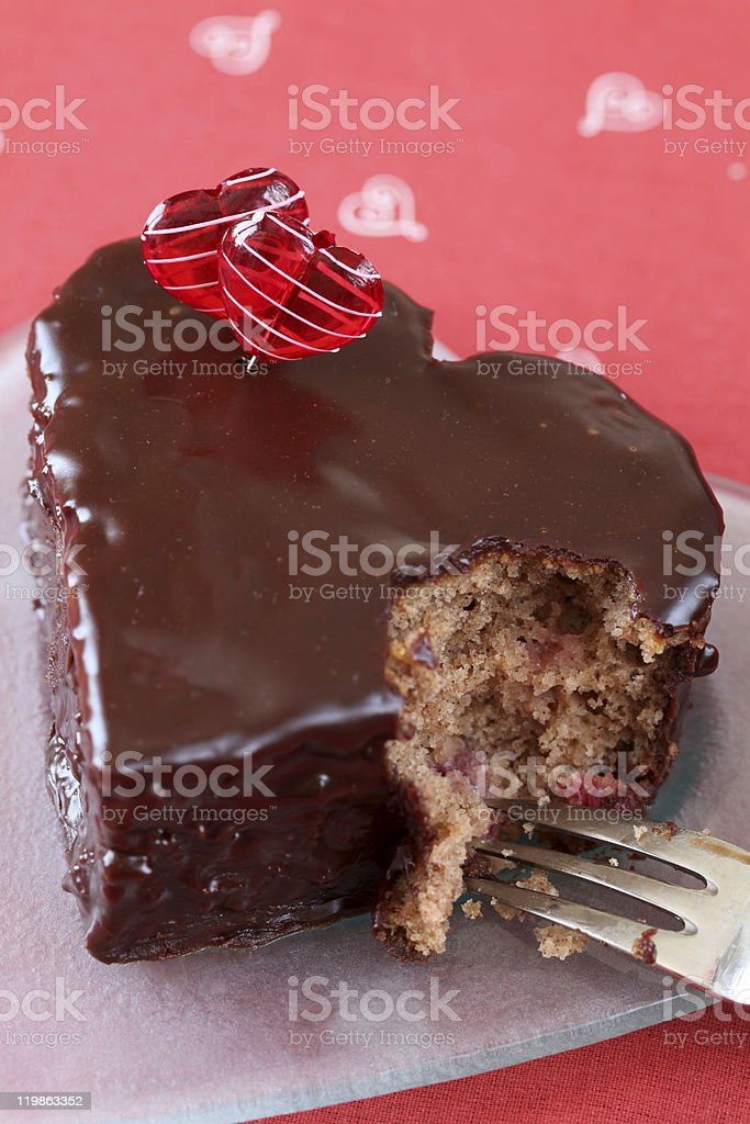 Heart shaped chocolate cake with a bite royalty-free stock photo