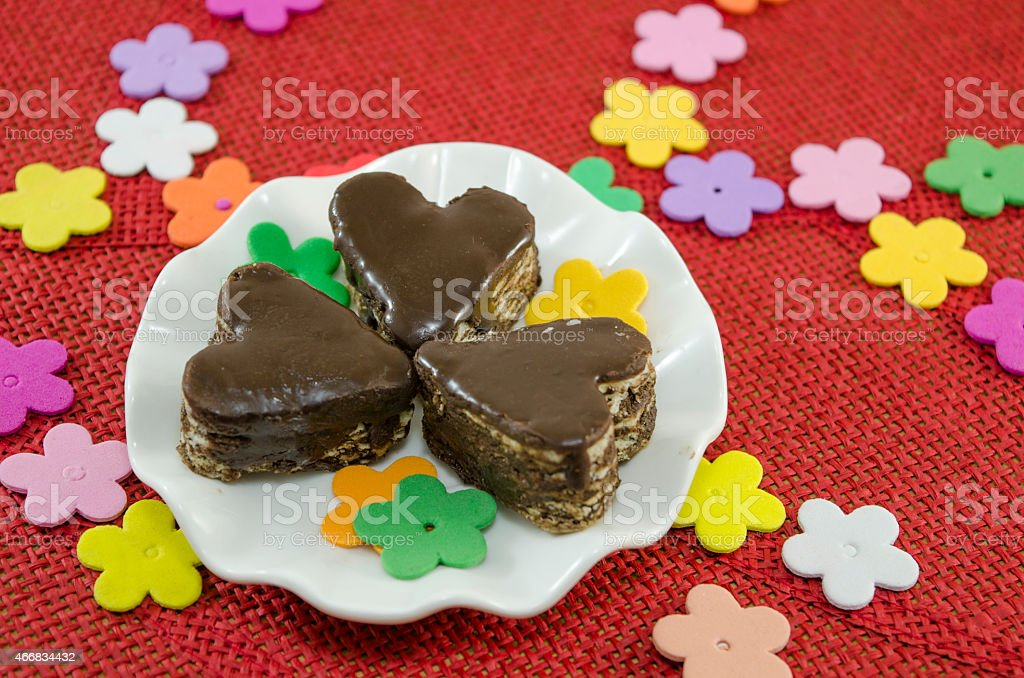 Heart shaped chocolate cookies on a plate royalty-free stock photo