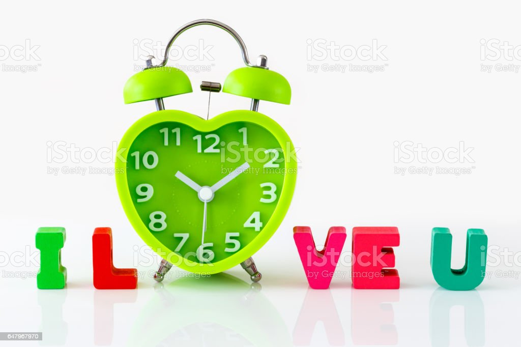 Heart Shaped Clock Wooden Alphabets for Valentin's Concept stock photo