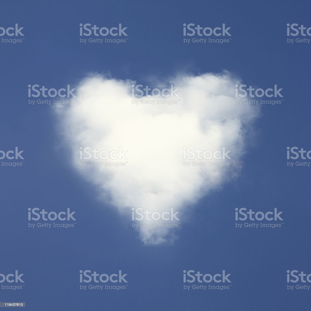 Heart shaped clouds on blue sky background. royalty-free stock photo