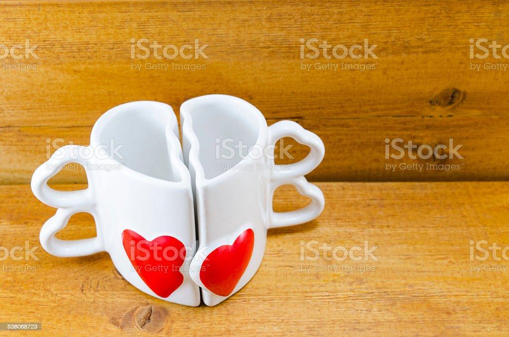 Heart shaped coffee mug on wooden background royalty-free stock photo