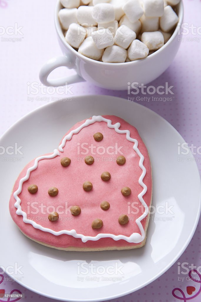 Heart shaped cookie and hot chocolate with marshmallows royalty-free stock photo