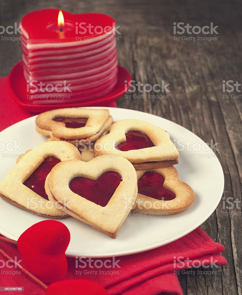 Heart shaped cookie with jam stock photo