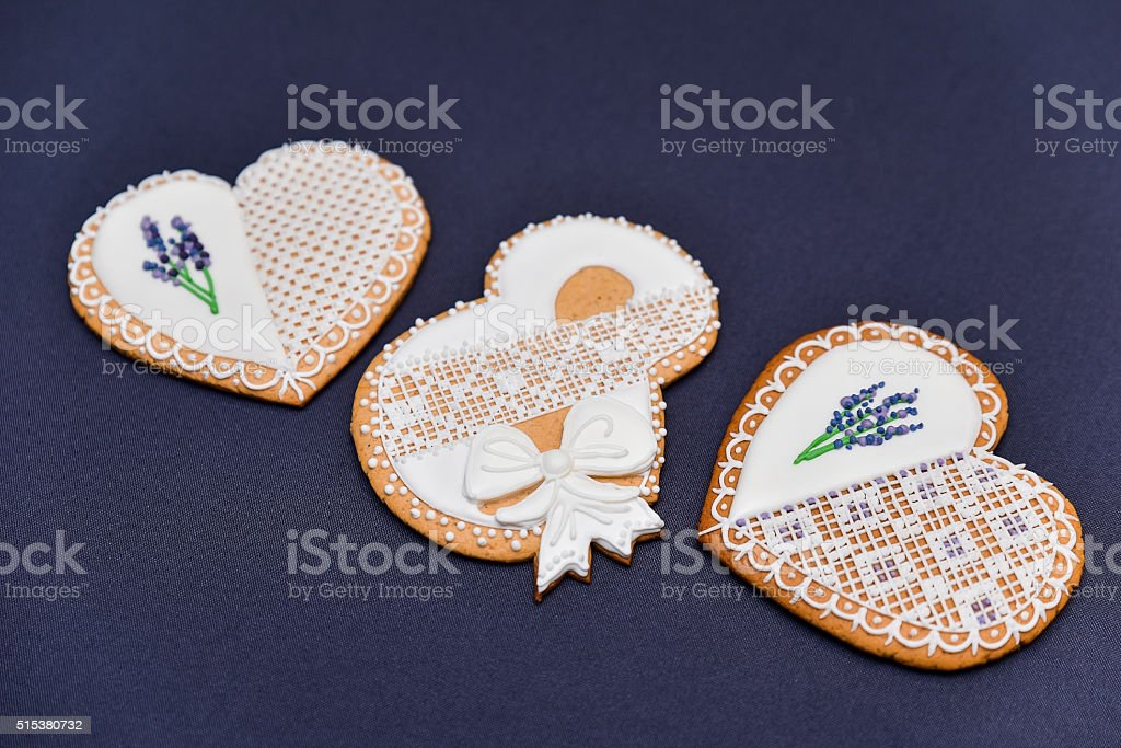 Heart shaped cookie with royal icing openwork with lavender. stock photo