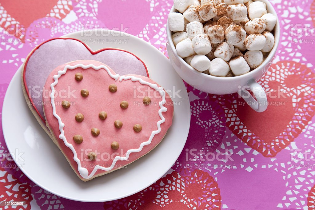 Heart shaped cookies and hot chocolate with marshmallows royalty-free stock photo