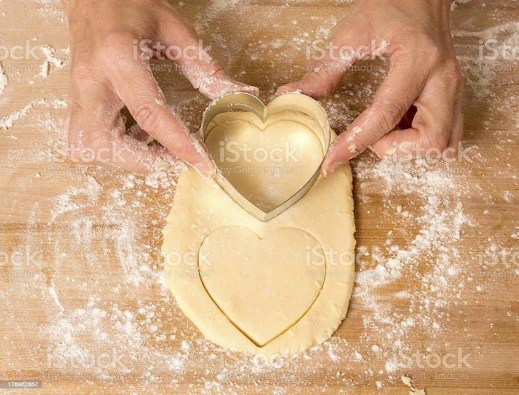 Heart Shaped Cookies Being Cut royalty-free stock photo
