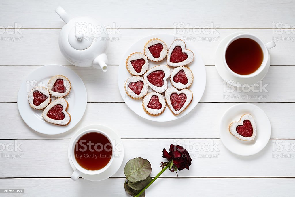 Heart shaped cookies for Valentines day with teapot, two cups stock photo