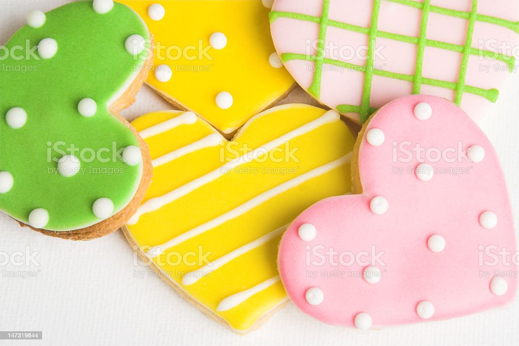 Heart shaped cookies in pink yellow and green stock photo