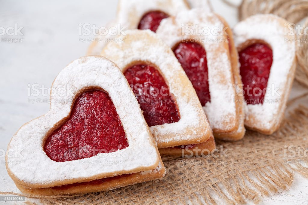 Heart shaped cookies with jam for valentine's day on textile stock photo