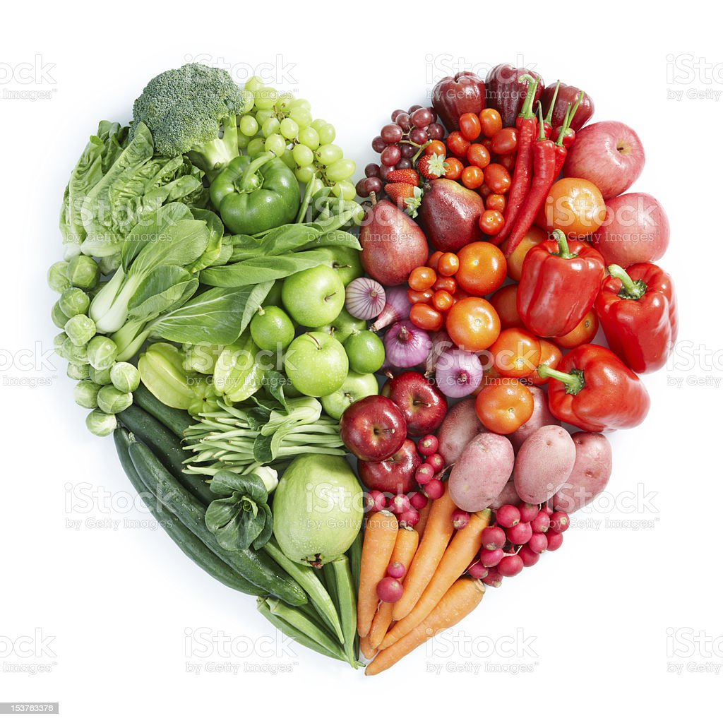 Heart shaped display of green, red healthy foods stock photo