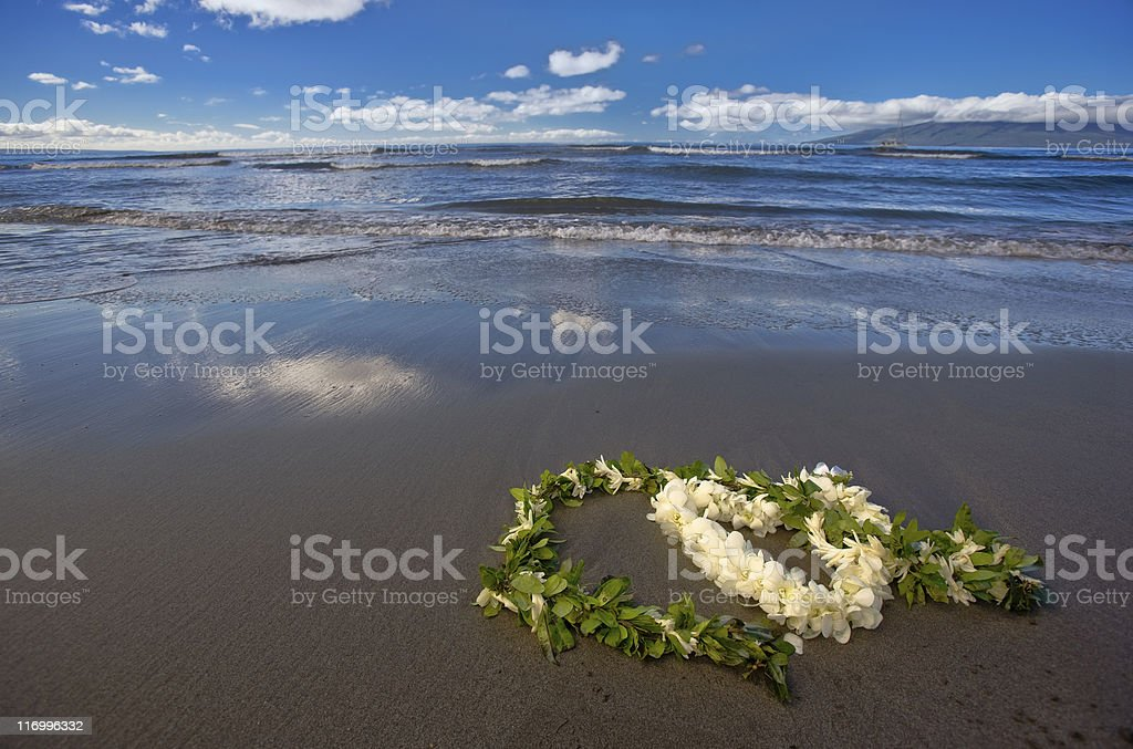 Heart shaped flower lei and garland on beach royalty-free stock photo