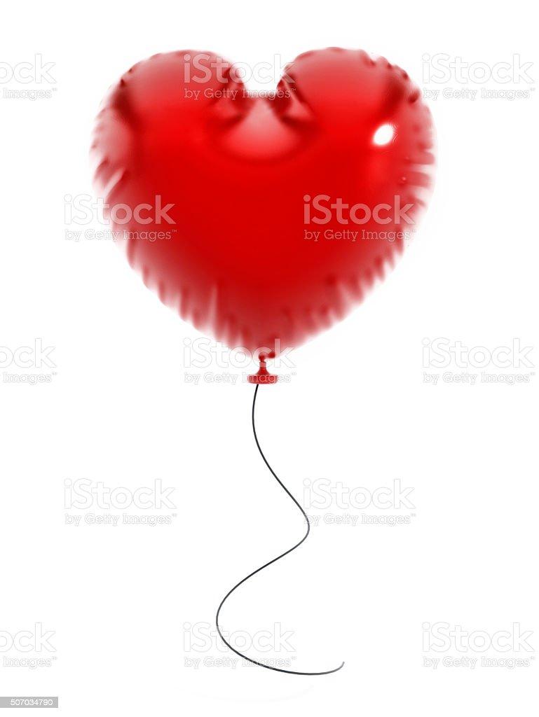 Heart shaped flying balloon stock photo