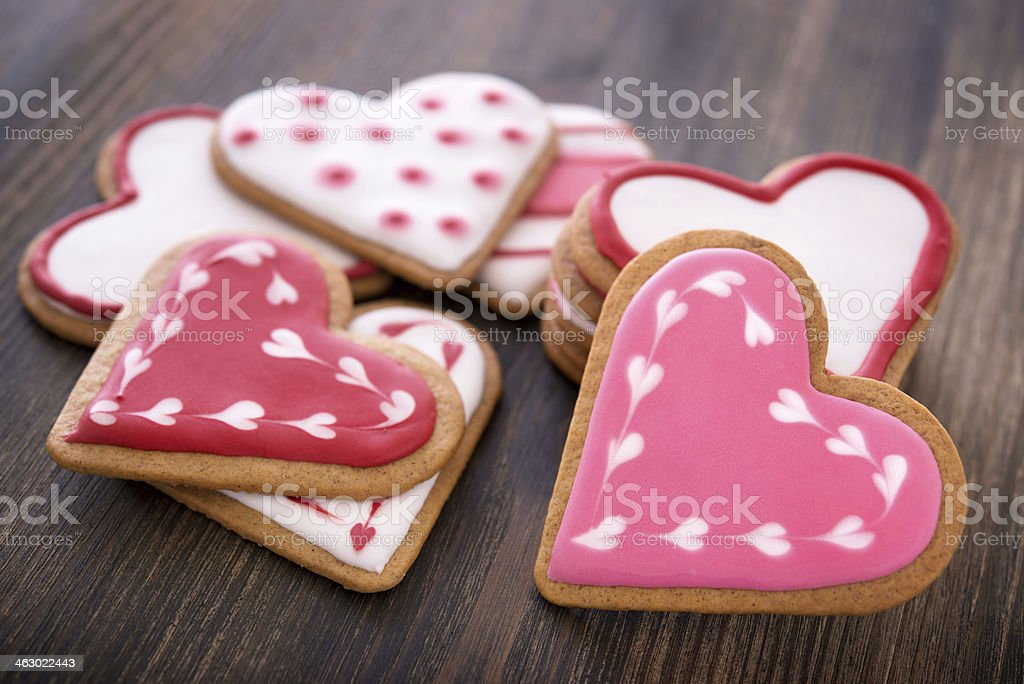Heart shaped ginger cookies on wooden background stock photo
