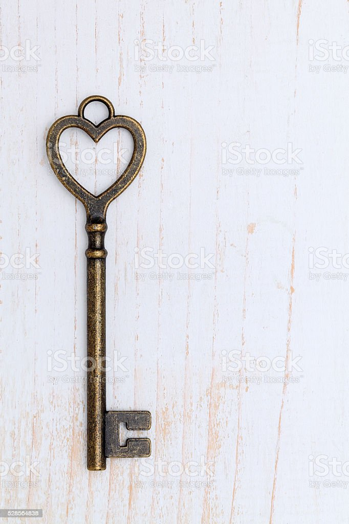 Heart shaped golden vintage key stock photo