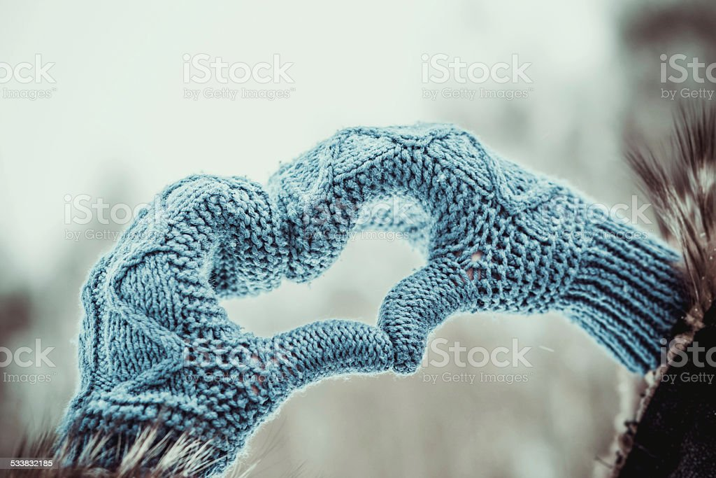 Heart shaped hands in the gloves outdoor stock photo