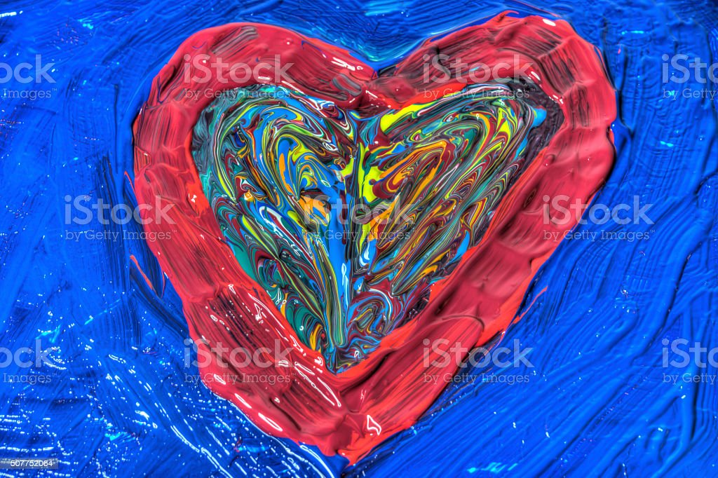 Heart shaped mixed painted colors stock photo