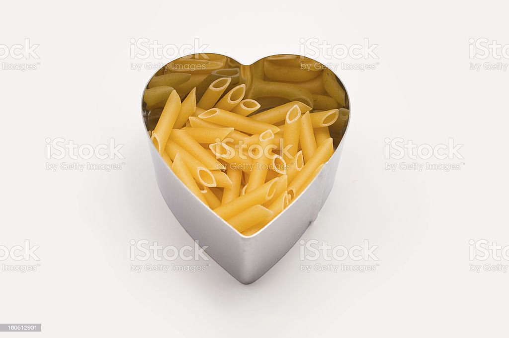 heart shaped mold filling penne rigate royalty-free stock photo