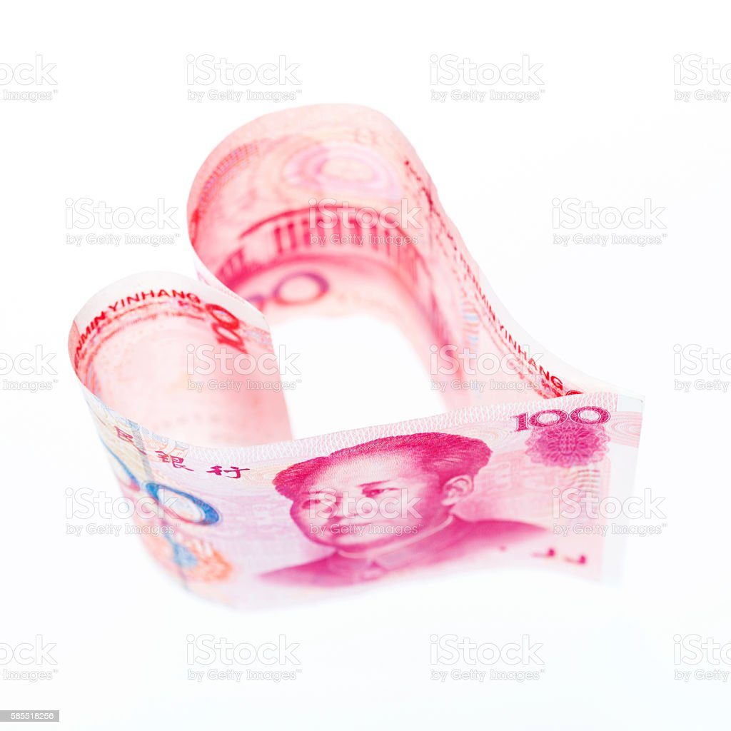 Heart shaped money stock photo