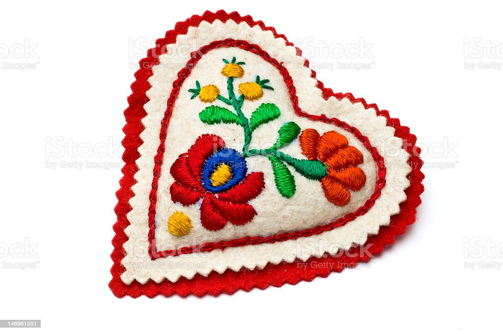 Heart shaped needle pillow decorated with Hungarian embroidery royalty-free stock photo