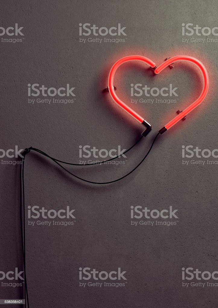 Heart shaped neon light stock photo