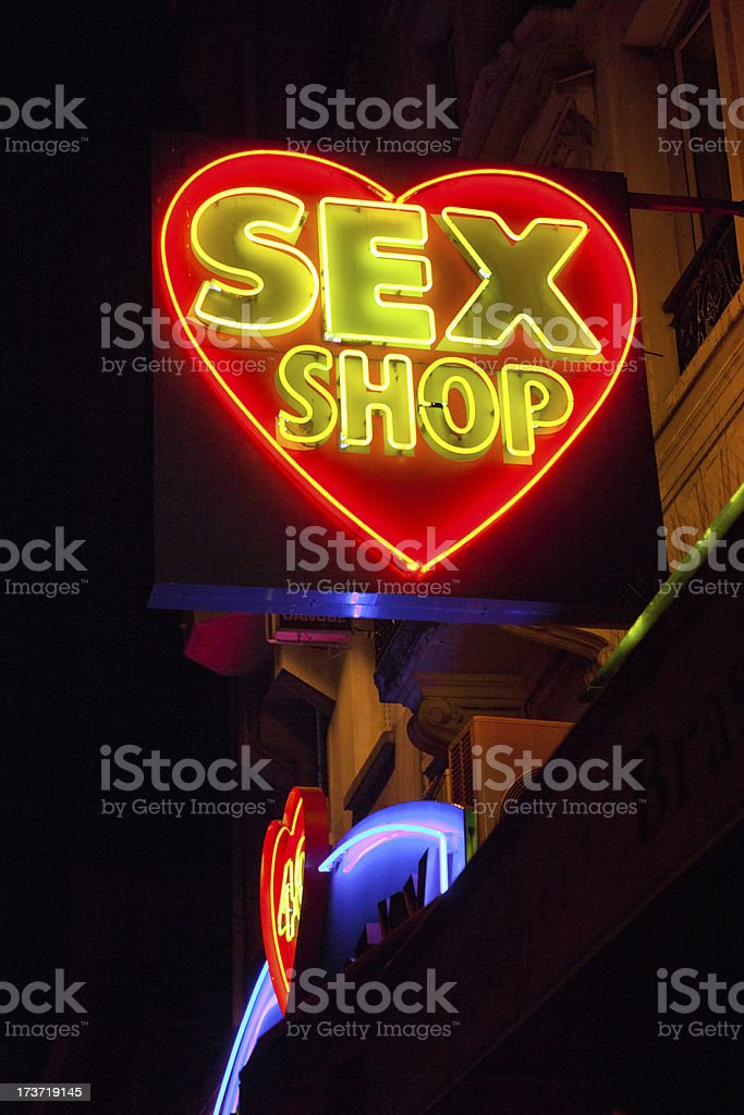 Heart shaped neon sex shop sign royalty-free stock photo