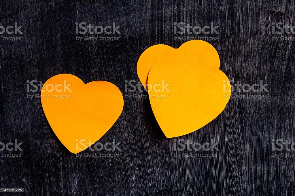 Heart shaped notes on blackboard royalty-free stock photo