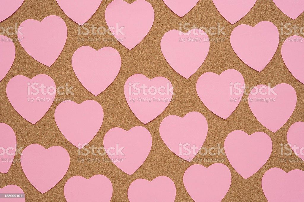 Heart Shaped Notes on Bulletin Board royalty-free stock photo