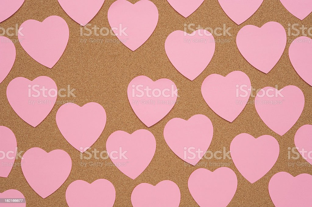 Heart Shaped Notes on Bulletin Board royalty-free stock photo