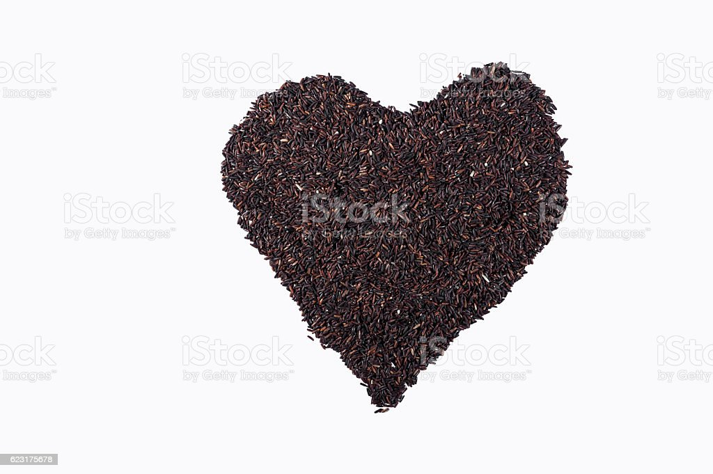 Heart shaped of  Riceberry rice , isolated on white background. stock photo