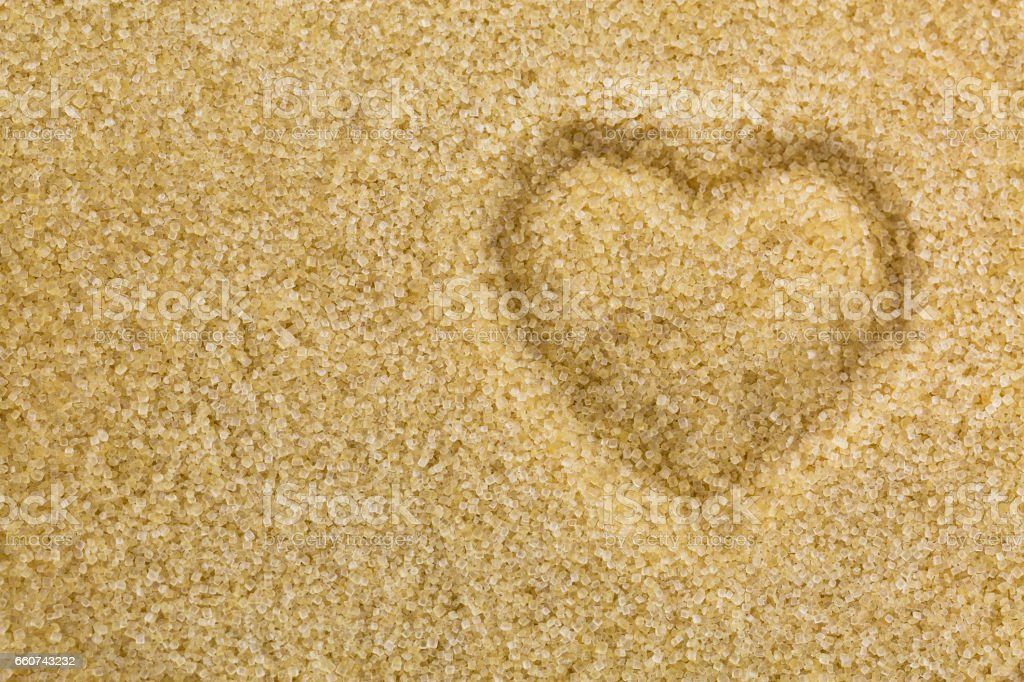 Heart shaped on unrefined unbleached Crystalline sugar in crystal brown color stock photo