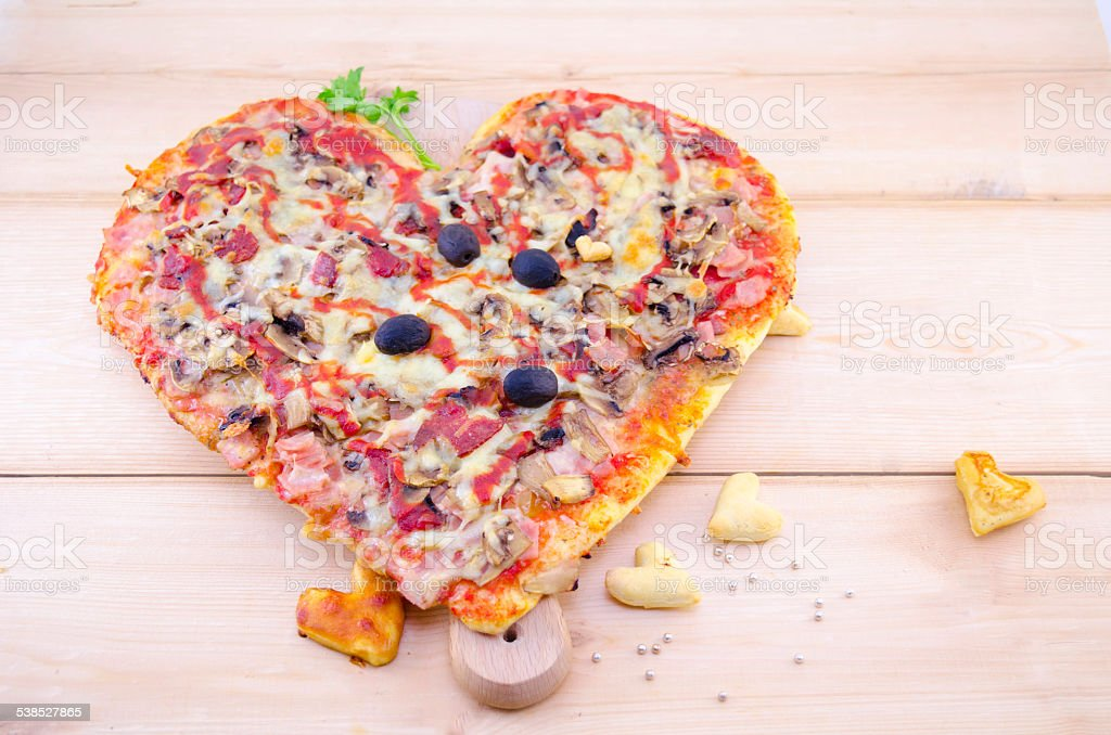 Heart shaped pizza and home made pastry royalty-free stock photo