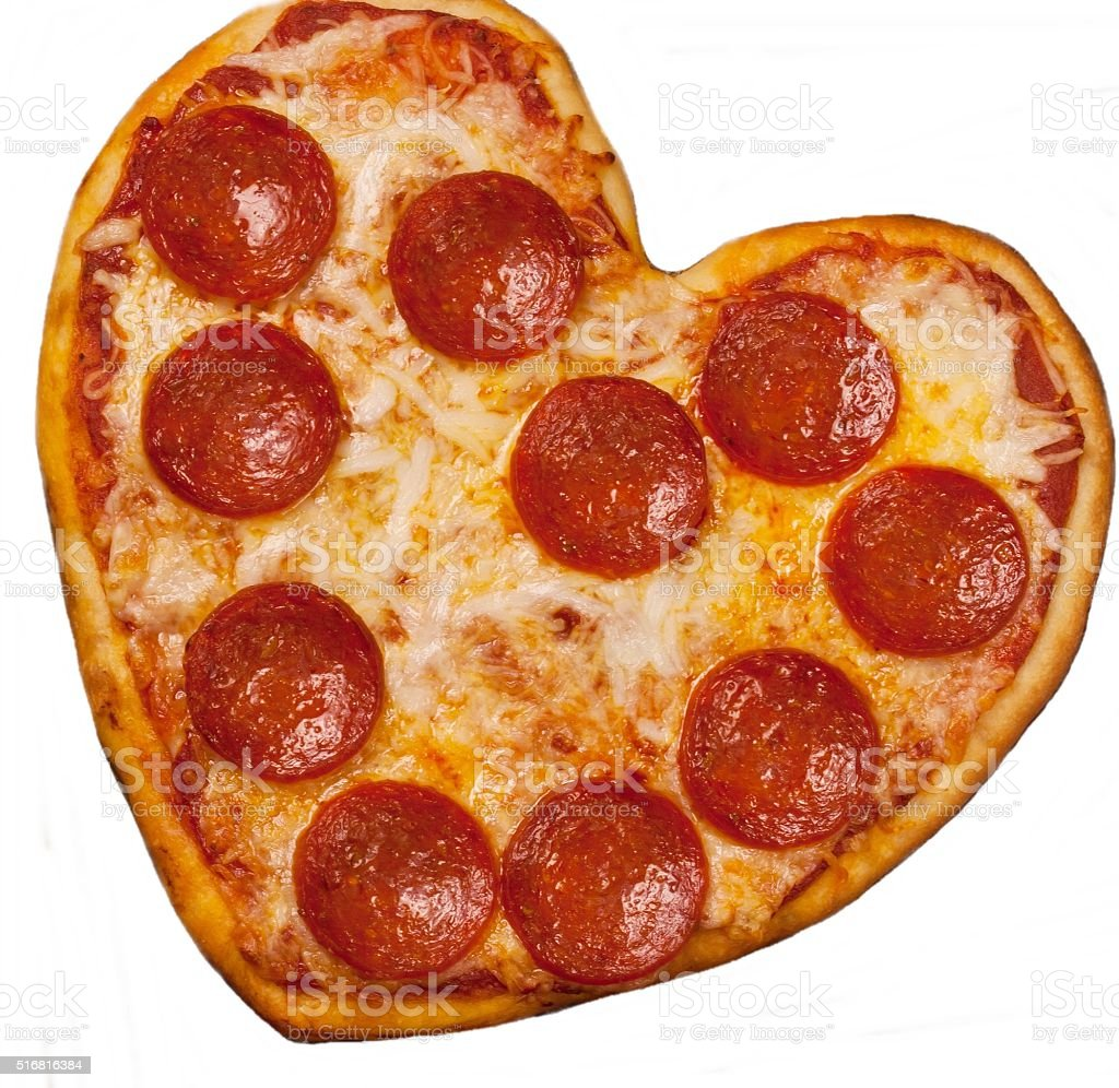 Heart shaped Pizza for Valentine's day stock photo