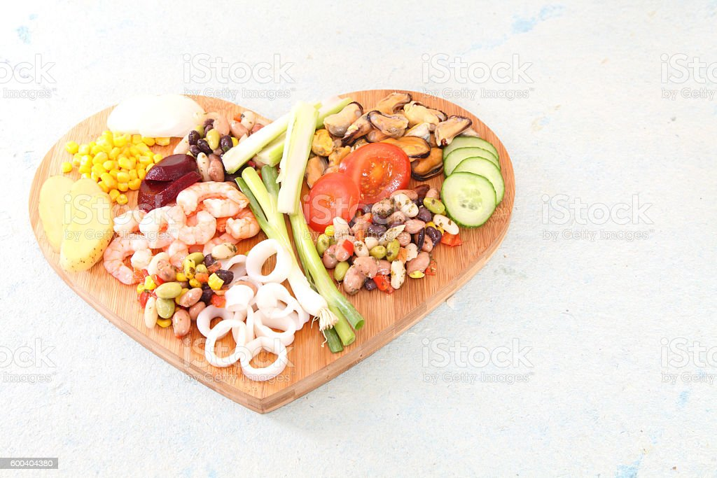 heart shaped platter of seafood  for a stir fry stock photo