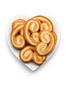 Heart shaped puff pastry on white plate