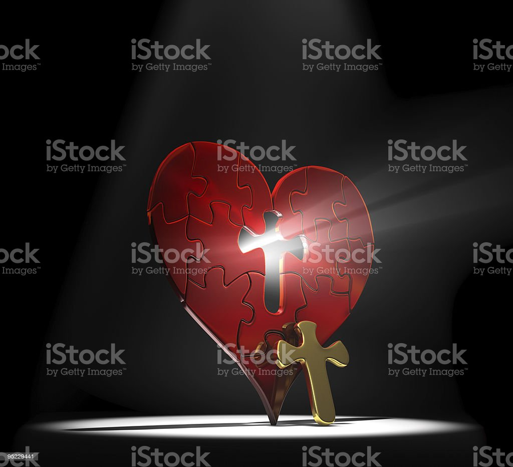 Heart shaped puzzle with a cross removed from the center stock photo