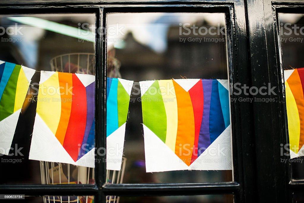 Heart shaped rainbow bunting stock photo