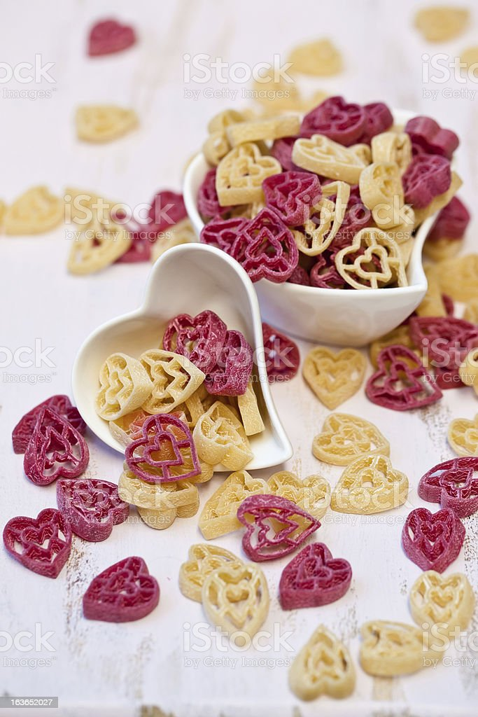 Heart shaped red and white pasta in bowl royalty-free stock photo