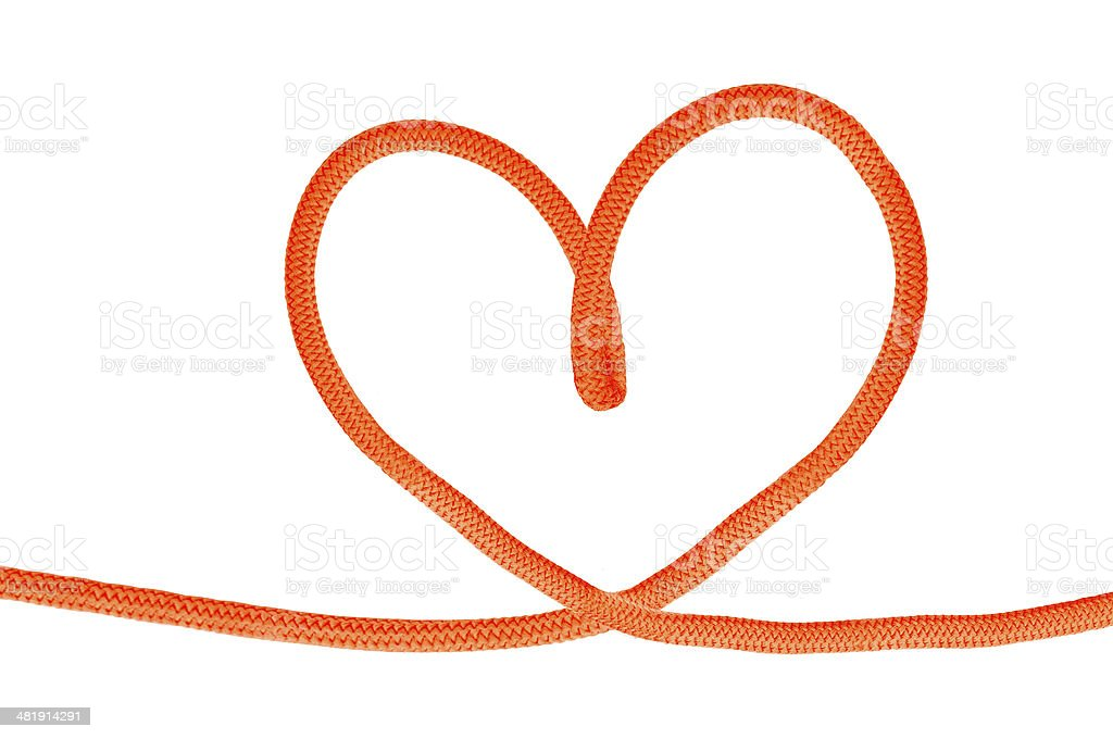 Heart shaped red knot on a jute rope royalty-free stock photo